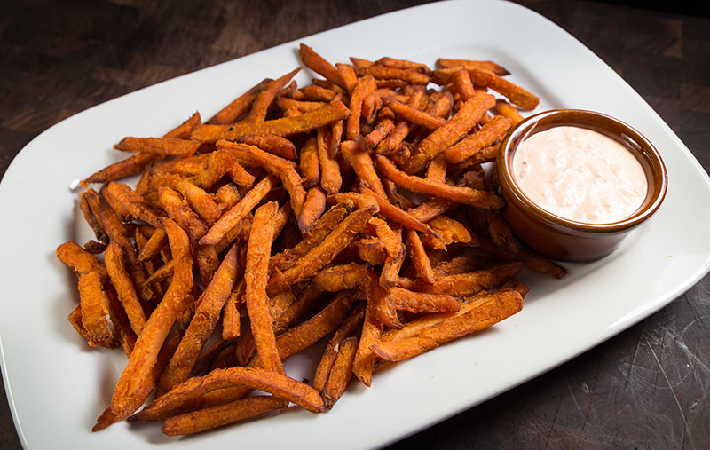 sweet potato frieswith ketchup and sriracha sauce