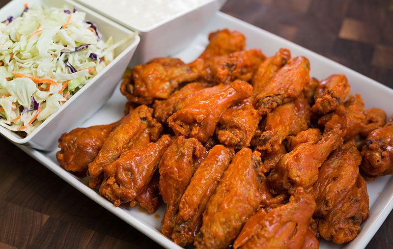black pepper garlic wings with house coleslaw and ranch