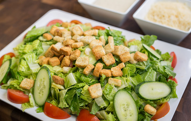 caesar saladwith romaine lettuce, tomatoes, parmesan cheese, croutons and caesar dressing