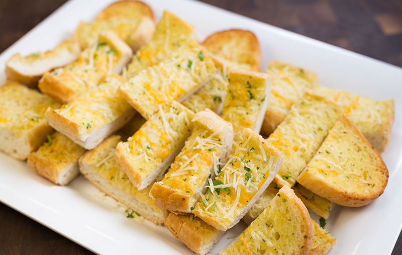 cheesy garlic breadfrench bread with garlic butter and four cheese mix